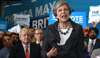 Prime Minister Theresa May speaks at a rally while on the General Election campaign trail, in Slough, England, Tuesday, June 6, 2017.