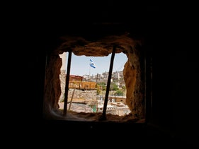 A general view taken on May 8, 2017 shows houses owned by Jewish families before the 1967 Six-Day war and now occupied by Jewish settlers in the West Bank city of Hebron.