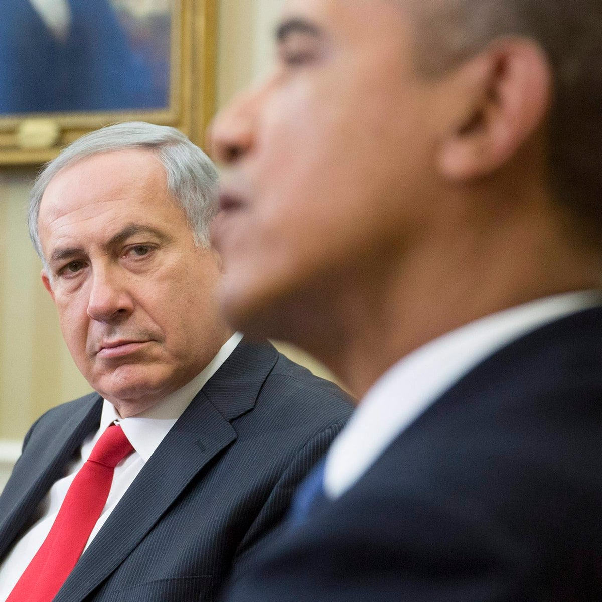 Prime Minister Benjamin Netanyahu looking on as then-U.S. President Barack Obama speaks in the White House in Washington, March 3, 2014.