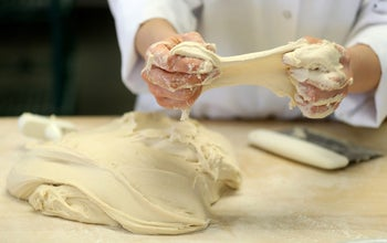ILLUSTRATION: A technical specialist in baking technology stretches pulse flour dough at the Canadian International Grains Institute lab research lab in Winnipeg, Manitoba, Canada, on Wednesday, Feb. 15, 2017.