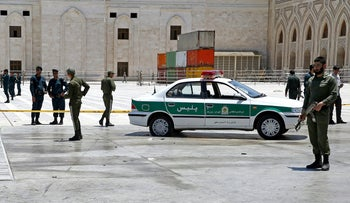 Police officers control the scene, around of shrine of late Iranian revolutionary founder Ayatollah Khomeini, after an assault of several attackers in Tehran, Wednesday, June 7, 2017.
