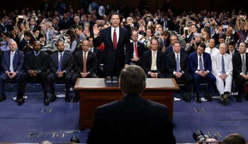 Former FBI Director James Comey being sworn in to testify before the Senate Intelligence Committee hearing in Washington, June 8, 2017.