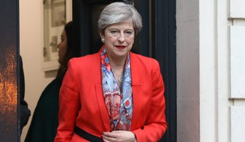 Theresa May, U.K. prime minister and leader of the Conservative Party, leaves the Conservative Party campaign headquarters in London, U.K., on Friday, June 9, 2017.