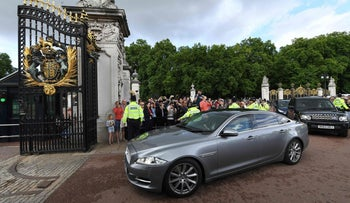 Britain's Prime Minister and leader of the Conservative Party Theresa May arrives at Buckingham Palace to meet Queen Elizabeth II.