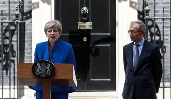 Theresa May, U.K. prime minister and leader of the Conservative Party, delivers a speech as her husband Philip May, watches outside number 10 Downing Street in London, U.K., on Friday, June 9, 2017.