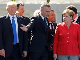 U.S. President Donald Trump, NATO Secretary-General Jens Stoltenberg and German Chancellor Angela Merkel with NATO member leaders before the start of their summit in Brussels, May 25, 2017.