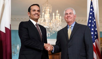 Secretary of State Rex Tillerson, right, shakes hands with Qatari Foreign Minister Sheikh Mohammed bin Abdulrahman bin Jassim Al Thani, Monday, May 8, 2017, at the State Department in Washington.