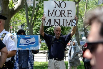 """A man holds a placard during an event called """"March Against Sharia"""" in New York City, U.S., June 10, 2017."""