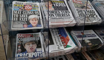 British Newspapers fronted with photos of British Prime Minister Theresa May and others are displayed at a shop in Westminster, London, June 10, 2017.