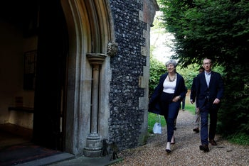 British Prime Minister Theresa May and her husband Phillip arriving at church in Sonning, west of London, June 11, 2017.