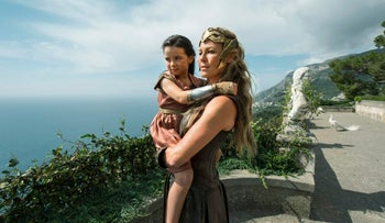 "Connie Nielsen (right) and Lilly Aspell as Queen Hippolyta and young Wonder Woman in a scene from the film ""Wonder Woman."""