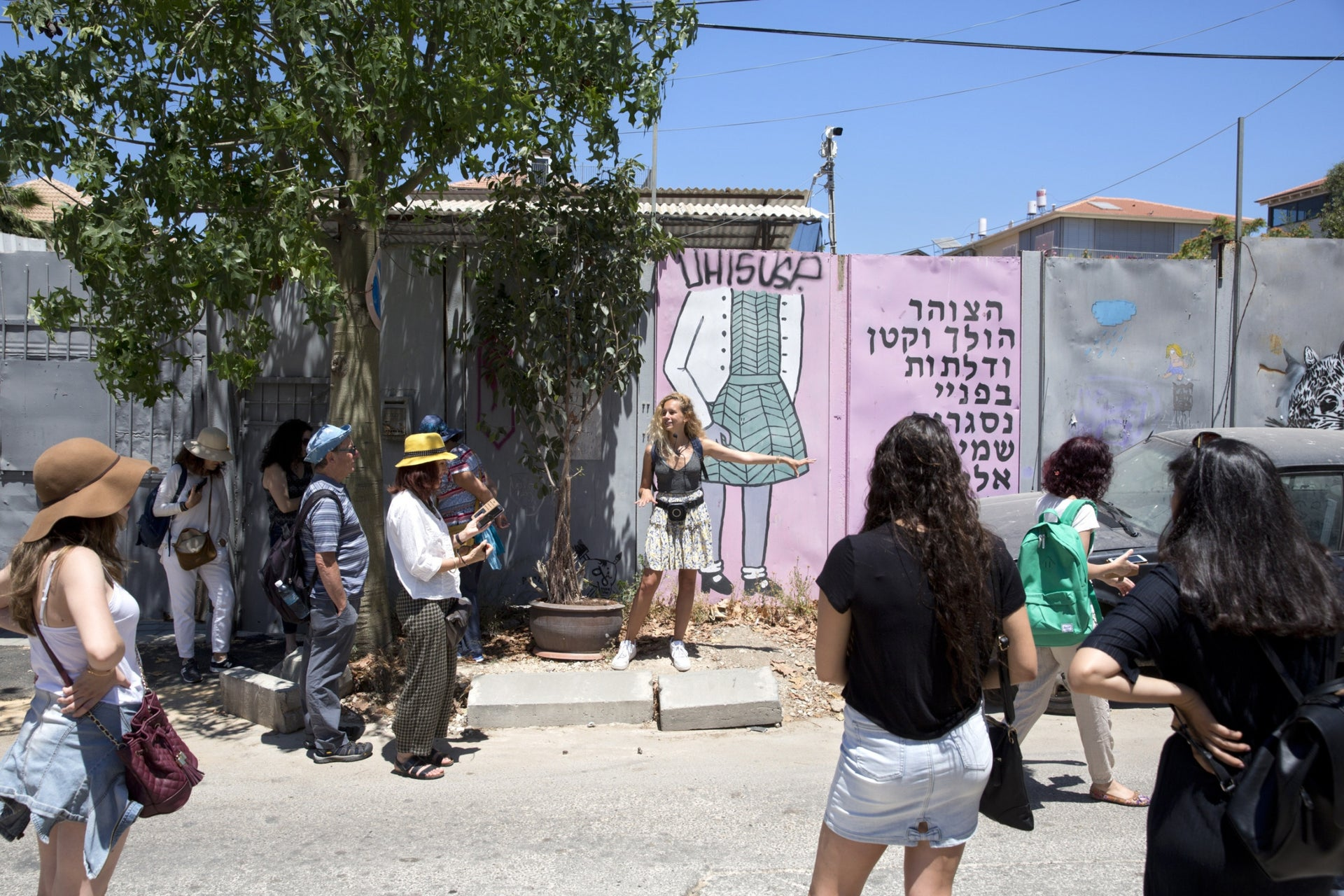 Tourists listening as their tour guide talks about street art in the Florentin neighborhood, south Tel Aviv, May 26, 2017.