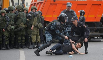 Riot police detain a demonstrator during an anti-corruption protest organized by opposition leader Alexei Navalny, Moscow, Russia June 12, 2017.