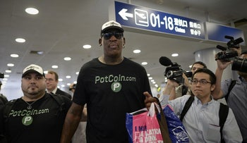 Former NBA basketball player Dennis Rodman arrives to check-in for his flight to North Korea at Beijing's international airport in China, June 13, 2017.