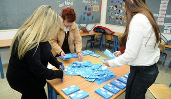 Votes being counted at a polling station by officials following Israel's January 22, 2013 election.