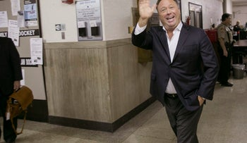 In this April 19, 2017, file photo, Alex Jones, a well-known Austin-based broadcaster and provocateur, arrives for a child custody trial in Austin, Texas.