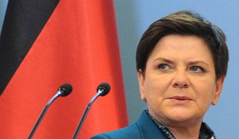 Polish Prime Minister Beata Szydlo arrives at a press conference.