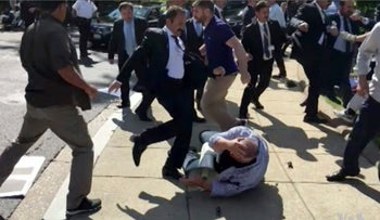 In this frame grab from video provided by Voice of America, members of Erdogan's security detail are shown violently reacting to peaceful protesters during Erdogan's trip last month to Washington.