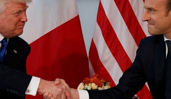 President Donald Trump shakes hands with French President Emmanuel Macron during a meeting at the U.S. Embassy, Thursday, May 25, 2017, in Brussels.