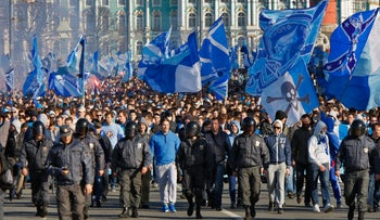 File photo: Football fans march before the national soccer Championship in St.Petersburg, Russia. April 28, 2012.