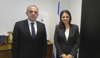 Justice Minister Ayelet Shaked with Turkish Ambassador Kemal Okem in her office in Jerusalem on June 15, 2017.