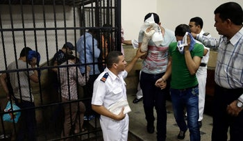 Eight men convicted for 'inciting debauchery' following their appearance in a video of an alleged same-sex wedding party are seen in court, Cairo, Egypt.