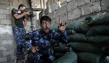 Members of Iraq's elite Counter-Terrorism Service inside a building during the advance towards the Old City of Mosul on June 19, 2017.