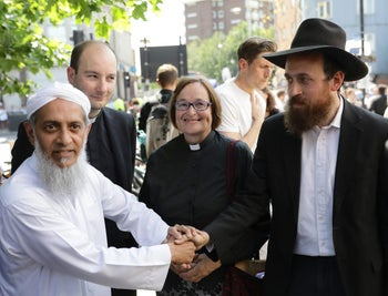 Local faith leaders standing together near Finsbury Park mosque in London, June 19, 2017.