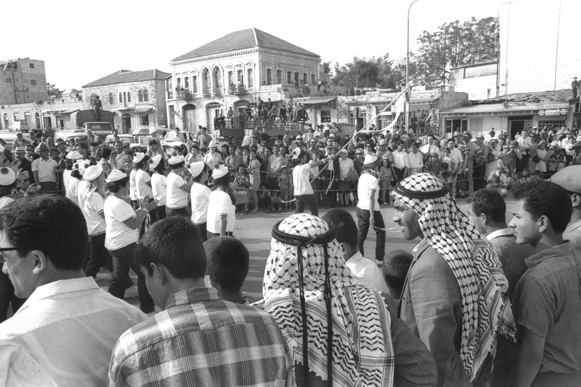 Jews and Arabs watching an Independence Day march near Damascus Gate in 1969.