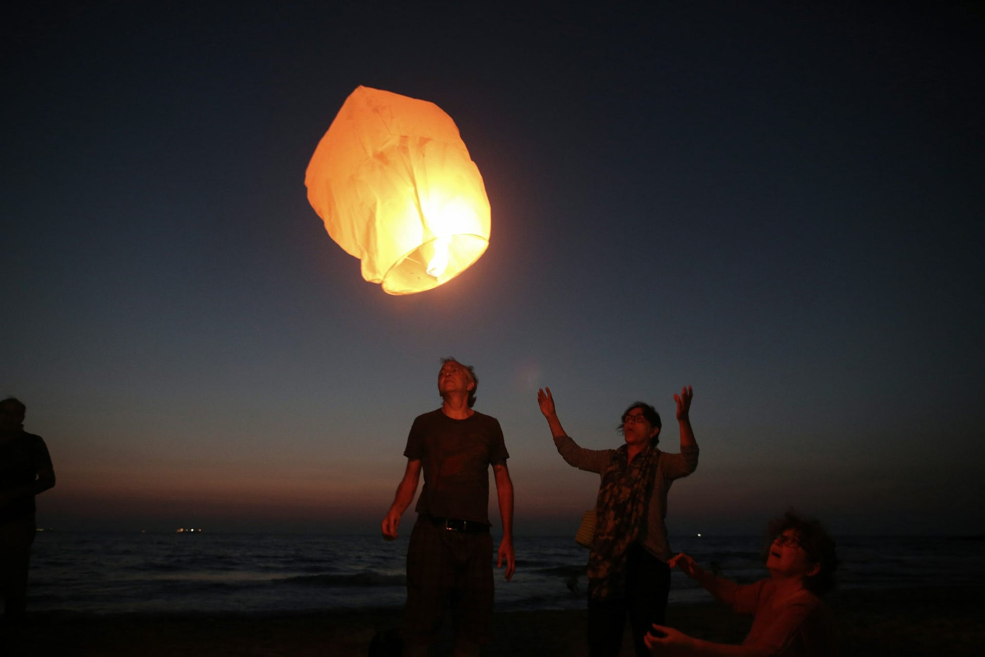 Israeli peace activists release a sky lantern, hoping to illuminate the sky in Gaza, as they protest Israel's reduction of power supply to Gaza at a beach in Ashkelon, southern Israel, June 19, 2017.