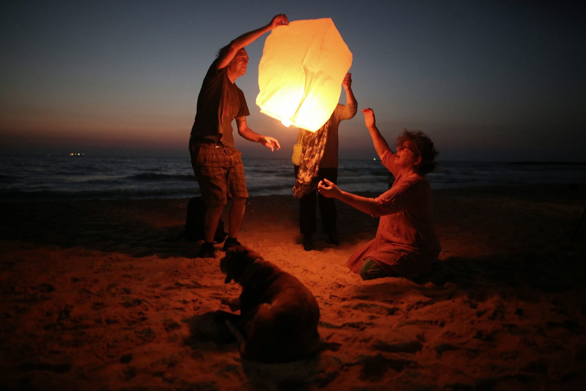 Israeli peace activists release a sky lantern, hoping to illuminate the sky in Gaza, as they protest Israel's reduction of power supply to Gaza at a beach in Ashkelon, June 19, 2017.