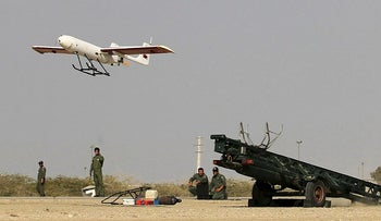 A picture made available on December 25, 2014 by Iranian Jamejam newspaper's website (Jamejam online) shows Iranian Army ground forces launching an Iranian made drone