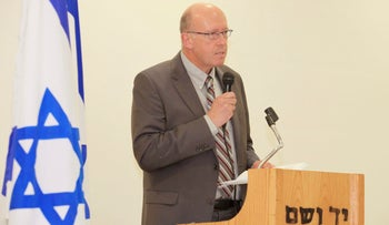 Holocaust historian Jan Grabowski gives a speech at Yad Vashem, the Israeli Holocaust research center, during a ceremony in which he was awarded for his scholarship, in Jerusalem, Israel. Dec. 8, 2014.
