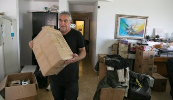 Resident Yoni Yochanan is seen packing his possessions after receiving an eviction order, Lifta, near Jerusalem, Israel, June 20, 2017.