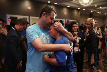 Matthew Levy and Sheila Levy are overcome with emotion after Democratic candidate Jon Ossoff delivers a concession speech on June 20, 2017 in Atlanta, Georgia.