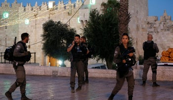 Policemen secure the scene of the shooting and stabbing attack outside Damascus gate in Jerusalem's Old City, June 16, 2017.