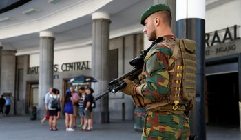 A Belgian soldier stands guard outside Brussels central railway station in Brussels, Belgium, June 21, 2017.
