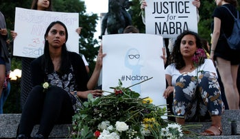 Attendees leaves flowers for Nabra Hassanen, a teenage Muslim girl killed by a bat-wielding motorist near a Virginia mosque, during a vigil in New York City, June 20, 2017.