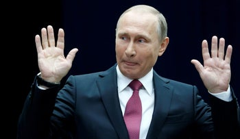 Russian President Vladimir Putin gestures as he speaks to journalists following a live nationwide broadcast call-in in Moscow, Russia June 15, 2017.