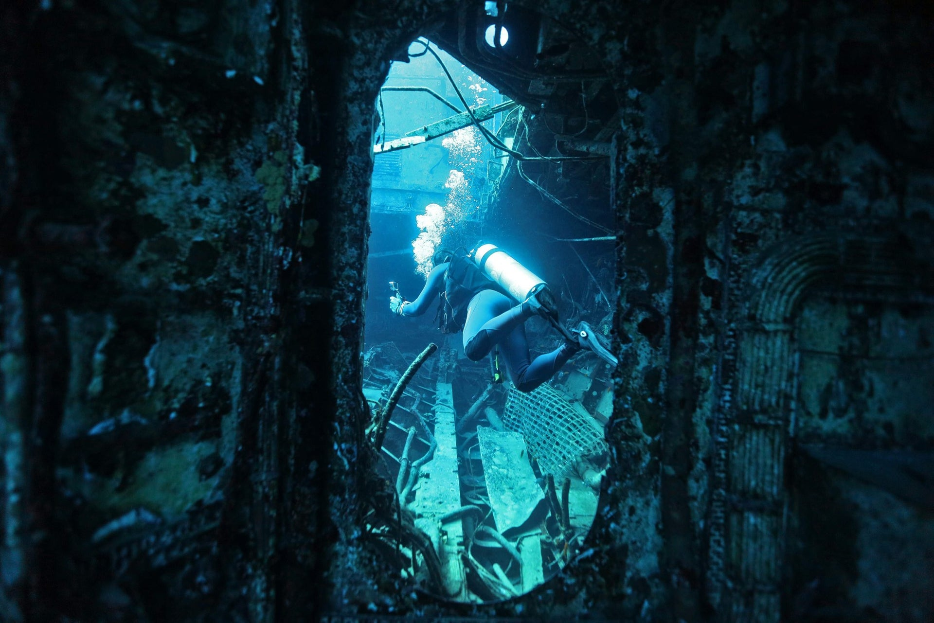 A scuba diver is seen at the wreck of a ship in the Red Sea off the southern Israeli resort city of Eilat on June 12, 2017.