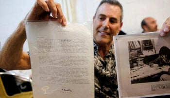 Uri Geller displaying the letter from Nobel Prize-winning physicist Albert Einstein he bought during an auction in Jerusalem auction on June 20, 2017.