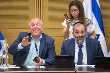 MK David Amsalem, left, with Interior Ministry Arye Dery at the Knesset Interior Committee meeting on asylum seekers in Jerusalem, June 21, 2017.