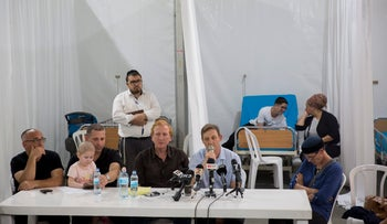 """Parents of children from the Hadassah cancer ward hold a media conference in the """"field hospital"""" they set up in Jerusalem's Sacher Park, June 4, 2017."""
