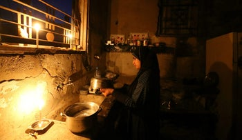 A Palestinian woman during a blackout in the southern Gaza Strip in June.