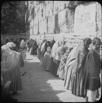 Women and men pray together at the Western Wall in Jerusalem, 1910.