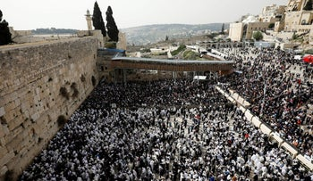 Jewish worshippers at the Western Wall during Passover, April 13, 2017.