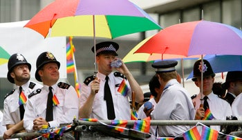 A file photo of British policemen holding rainbow umbrellas at in the London gay pride parade, June 30, 2007.