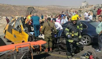 Emergency services at the scene of the crash on Route 60 in the West Bank, June 27, 2017.