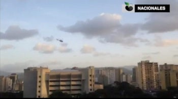 A police helicopter flies over Venezuela's Supreme Court building in Caracas June 27, 2017, in this still image taken from a video.
