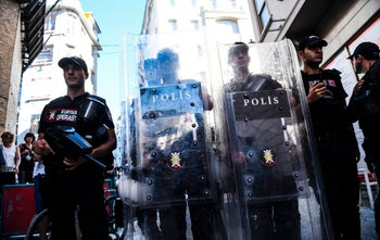 Turkish riot police officers blocking access to Istanbul's Istikjlal avenue fired rubber bullets at a group of around 40 LGBT rights activists trying to gather for a Pride parade, banned by the governorship. June 25, 2017.